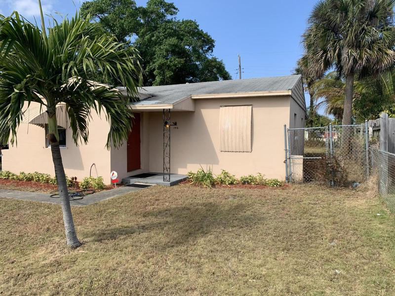 Image for property 142 25th Street, Riviera Beach, FL 33404